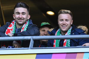 Kevin O'Connor and Seán Maguire (left) supporting their former club Cork City at the FAI Cup final in the Aviva Stadium on Sunday