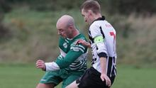 P.J. Bourke of Ballymurn Celtic is challenged by Liam Moore of Ajax Athletic