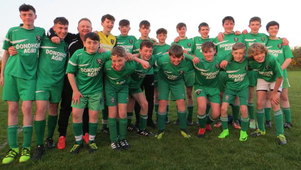 Cloughbawn celebrate their league title-winning performance