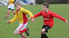 James Lawless (Moyne Rangers) tries to break away from Jamie Hudson (New Ross Celtic) in their Under-13 encounter