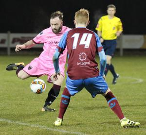 Mikey Byrne of Wexford F.C. takes aim as Drogheda United winger Mark Doyle closes in