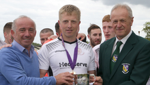 Tony Doyle, Managing Director of sponsors Creane and Creane Insurance, and Denis Hennessy of the Wexford Football League, presenting Wexford Bohemians captain David Lyttleton with the Wexford Cup