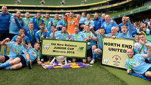 North End United players celebrate with the cup following the FAI New Balance Junior Cup Final match against Pike Roversn. Photo by Eoin Noonan/Sportsfile