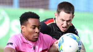 Wexford FC newcomer Success Edogun in a determined battle with Drogheda defender Jack Tuite