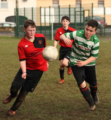 Jason Murphy (Camolin Celtic) and Max O'Neill (Gorey Celtic) are both eager to secure possession