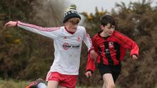 Ryan Boland of Gorey Rangers battling with Cormac Lyons (Kilmore United)