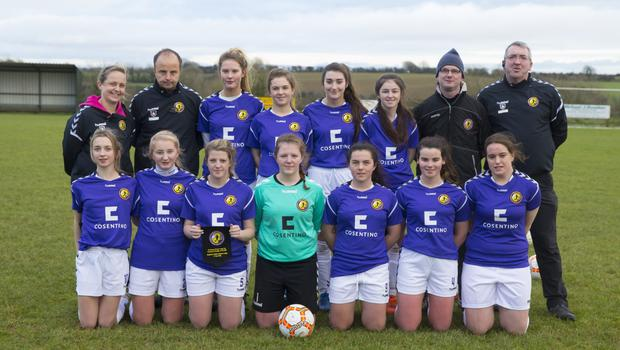 The Wexford starting eleven with their mentors