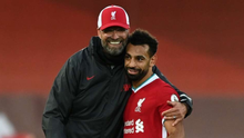 Hat-trick hero Mo Salah is embraced by Liverpool manager Jurgen Klopp