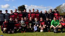 Wexford Bohs captain Ian Farrell and his team-mates with the Division 4 trophy