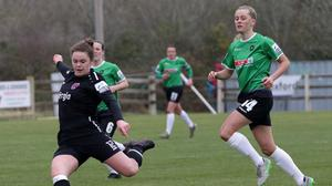 Ciara Rossiter getting plenty of power behind this shot as Peamount's Claire Walsh looks on