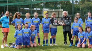 Coach Shirley Roche (left) with her North End United Under-12 team after the girls won the Premier Division title for the first time in the club's historic 50th anniversary year. Back (from left): Shirley Roche, Molly Thompson, Holly Dooley, Nicole Kelly, Mika Lawlor, Lisa Foley (receiving the plaque from league representative Mick Bennett), Kaitlyn Rossiter, Sadhbh Allen. Front (from left): Ciara Gordon, Alex Malone-Roche, Hannah Cullen, Lexi Turner, Sophie Kinsella, Shannon McGuire