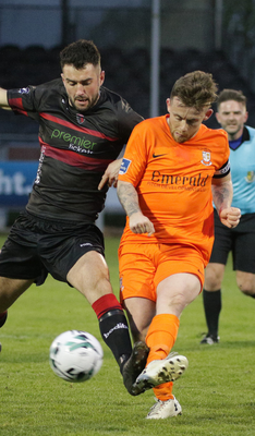 Thomas Croke of Wexford F.C. and Aaron Brilly of Athlone Town battle for possession