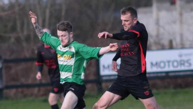 Lee Cullen of Gorey Celtic is challenged by Terry Gainfort of Bridge Rovers