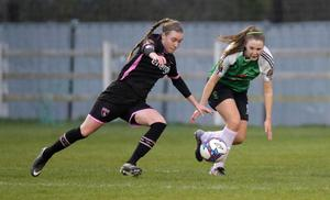 International striker Claire O'Riordan making life difficult for Chloe Moloney of Peamount United