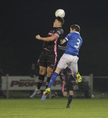Wexford Youths midfielder Lee Chin wins this duel in the air with Finn Harps captain Ciarán Coll