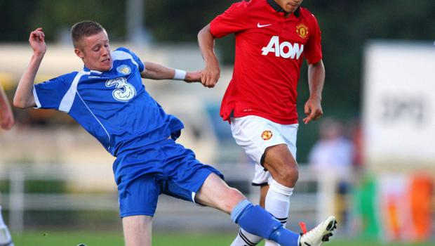 Kevin O'Connor challenges Andreas Pereira of Manchester United during a friendly in his time with former club Waterford United
