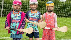 Joanne Feeney, Caoimhe McGovern and May Feeney ready for action at the Kellogg's Cúl Camp in Kilcoole.