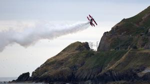 Bray Air Display: The G-EWIZ biplane comes in close to the cliff walk