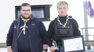 Arklow Venture Scout Shane O'Rourke, winner of the Albatross Race, with Arklow Scout Leader and National Sea Scout Team Lead Ciarán Deay.