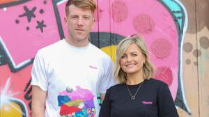 Stephen Considine and Tiffany Snell wearing the t-shirt designed in memory of Nadine Lott. Photo; Bobo Boutique.