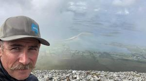 The late Carl Dempsey on top of Croagh Patrick during a recent family holiday.