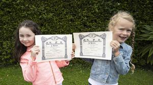 Zara Cooke (8) and Lara Ryan (7) receiving their Preliminary Grade certificates from Bray School of Speech and Drama.
