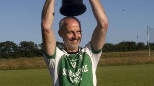 Avondale captain Seamus McGraynor hoists the Junior 'C' cup above his head after the Dales defeated Éire óg in the final in Ballinakill.