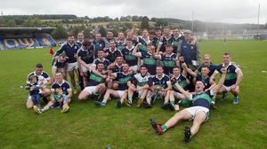 The Bray Emmets hurlers celebrate defeating Glenealy and winning the three-in-a-row for the second time.