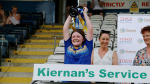 Wicklow captain Poppie Rose Cullen Dunne lifts the All-Ireland 'D' cup high after victory over Mayo in the final.