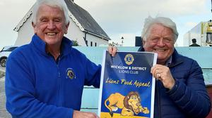 Sean Olohan and Don Conroy with the new Lions mascot and logo.