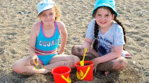 Brooke Bourke and Freya Byrne having fun playing in the sand on South Beach, Greystones.