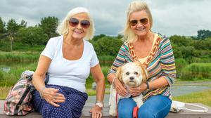 Sisters Angela and Alice O'Kane with 'Bella' relaxing at Arklow's North Beach.