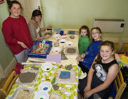 Having fun at making ceramics at the Ballyguile Communiy Arts Project.