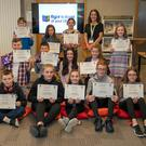 The winners of the Limerick competition, held in Arklow Library as part of the Right to Read programme, with competition organiser Treasa Houlihan