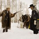 Kurt Russell and Samuel L. Jackson in a scene from The Hateful Eight