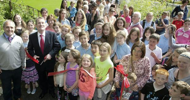 Chairman Mauriec Ramsay and Brian Stokes who's family donated the lease of the land for the park cut the ribbon at the opening of Ashford Park.