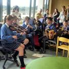 The Intermediate group of musicians from the Gaelscoil performing on the day