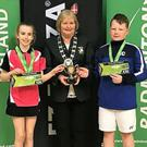 Eoghan Cooney and Siofra Flynn are presented with a cup for winning the U13 Mixed Doubles in the FZ Forza under-13 Masters National tournament held in Lisbon at the weekend