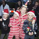 Pippa Cresswell, Cerys Cresswell, Alanna Synnott and Ryan Synnott having a good time at the switching on of the Christmas lights in Greystones