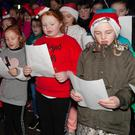 Local children singing carols at the switching on of the Christmas lights in Rathdrum
