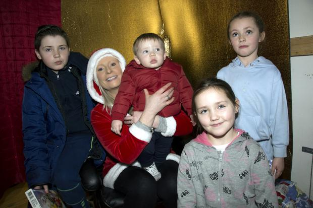 Isabella, Sienna, Noah, Alyssa and Ameira Duggan with Mrs Claus in Santa's Grotto in Blessington