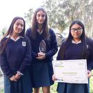 Dominican College students Leah Flynn, Ava Vickers and Síofra O'Leary with their Enterprise Award