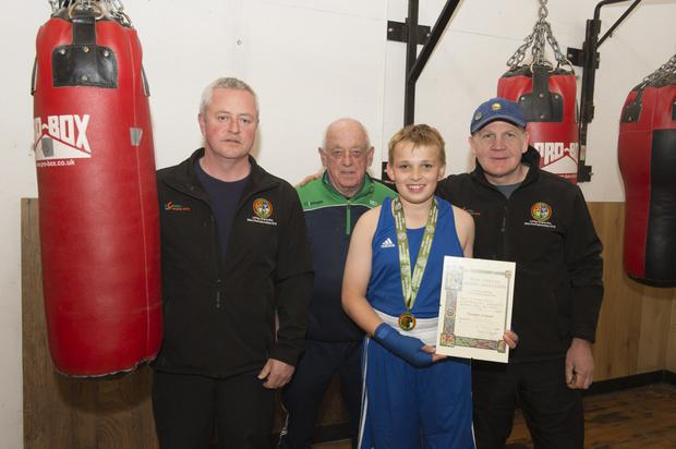 Glen McStay, under-11 All Ireland champion with Bobby Gill, Mick Douglas and Shane Murphy at the Fr. Flanagans Boxing Club in Blessington