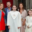 Kate Healy who received the sacrament of Confirmation at St Patricks CC, Kilcashel, Avoca, with her mam Kalinda, dad Darren and sisters Alex and Holly