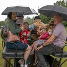 Sharon and Ryan Byrne, Seonag Kelly, Lea Byrne, Jacinta Kelly and Declan Byrne taking shelter during their Hansom Cab Ride at the Clash Fest at Ballinaclash