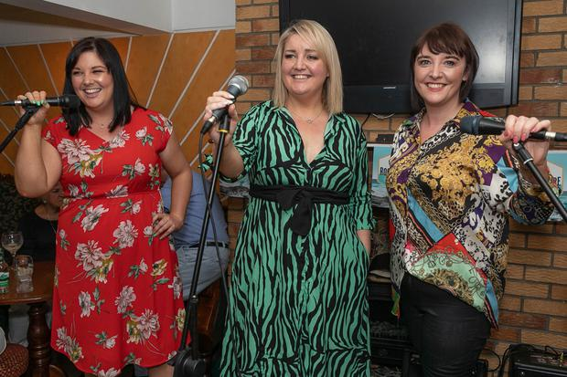 The Kinsella sisters, Emer, Aoife and Catriona singing 'Always a woman to me' at the Swinging Pubs competition in The Bridge Hotel