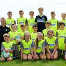 Boys and girls enjoying the FAI Summer Soccer School in Greystones: the under-13s group, with their coach Colum Tinsley
