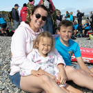 Natalia, Anna and Andriy Kravchenko watching the action at Wicklow Swimming club races