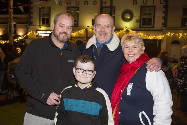 David Molloy, Cian Molloy, David Guilfoyle and Siobhan McGreevy-Guilfoyle at the switching on of the Christmas lights in Arklow