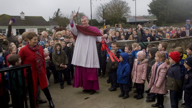 Bishop Denis Nulty cuts the ribbon with principal Mary O'Keeffe (left)
